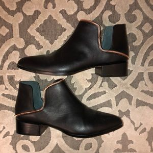 Black and rose gold halogen booties